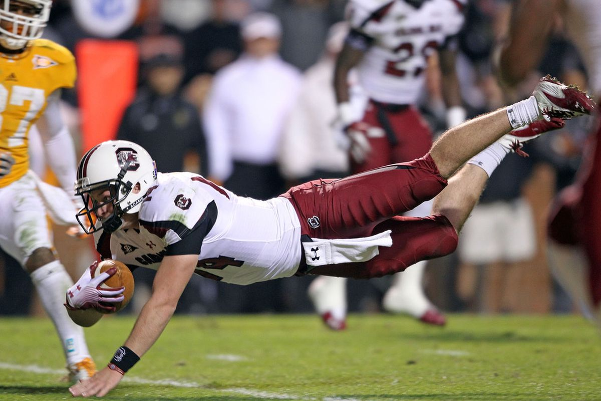 KNOXVILLE, TN - OCTOBER 29:  Connor Shaw #14 of the South Carolina Gamecocks dives for a touchdown during the game against the Tennessee Volunteers at Neyland Stadium on October 29, 2011 in Knoxville, Tennessee.  (Photo by Andy Lyons/Getty Images)
