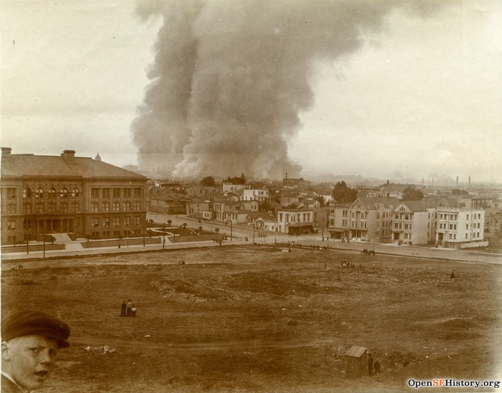 """1906: Written on back of photo: """"1 hour after earthquake"""" The boy's expression says it all. Also of note, all of the buildings on far side of park later burned."""