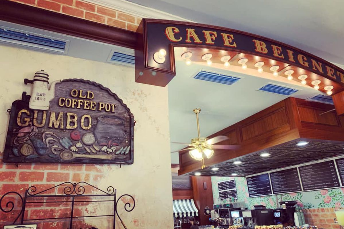 The Old Coffee Pot sign is next to a Cafe Beignet banner at the new incarnation of the 125-year old restaurant