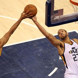 Golden State Warriors guard Shaun Livingston (34) and Utah Jazz center Rudy Gobert (27) reach for the rebound during game 4 of the second round of NBA playoffs at the Vivint Smart Home Arena in Salt Lake City on Monday, May 8, 2017.