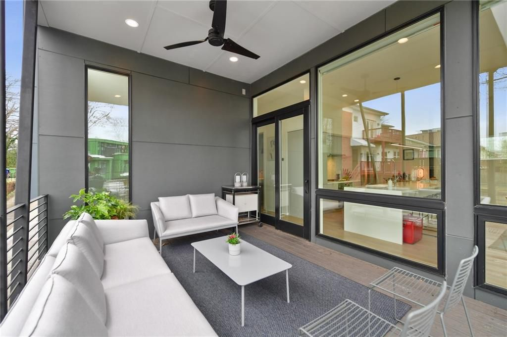 A modern home's grey covered side porch.