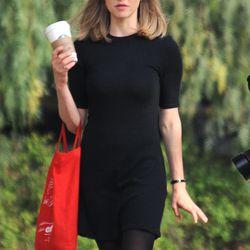 Amanda Seyfriend wore a black minidress and black tights on set in LA. Photo: Fame Flynet