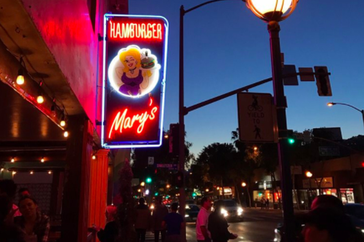 Hamburger Mary's signage shows in front of the restaurant at dusk.