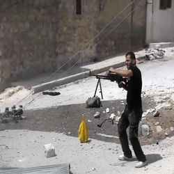 In this image made from video and accessed Saturday, Sept. 1, 2012, a Syrian rebel fires his weapon at Syrian Army positions during fighting in Aleppo, Syria. Syrian troops bombarded the northern city of Aleppo Saturday with warplanes and mortar shells as soldiers clashed with rebels in different parts of Syria's largest city, activists said. The Britain-based Syrian Observatory for Human Rights said the clashes were concentrated in several tense neighborhoods where some buildings were damaged and a number of people were wounded. (AP Photo via AP video)