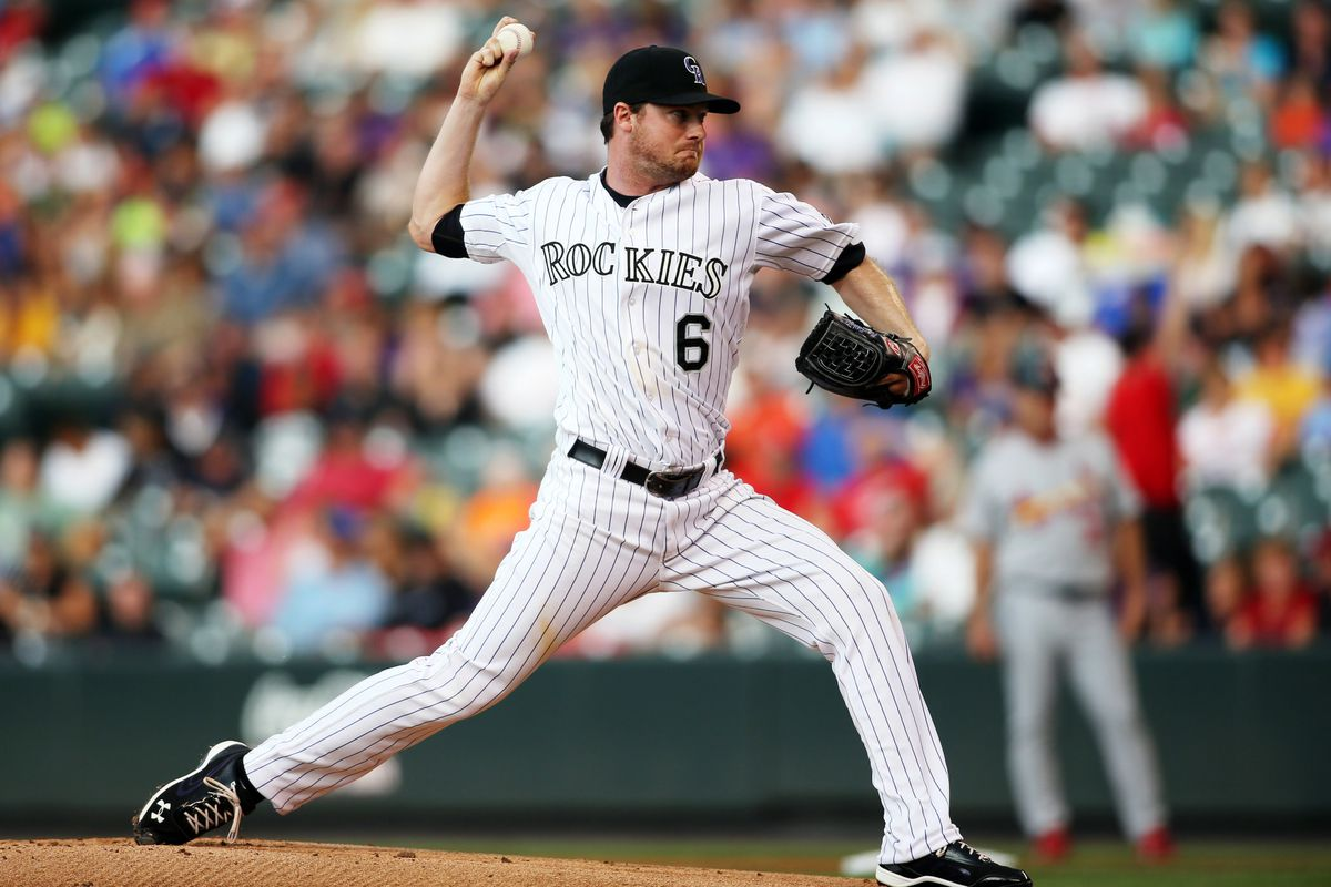 August 2, 2012; Denver, CO, USA; Colorado Rockies pitcher Alex White (6) delivers a pitch during the first inning against the St. Louis Cardinals at Coors Field. Mandatory Credit: Chris Humphreys-US PRESSWIRE