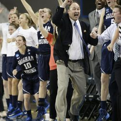 BYU head coach Jeff Judkins, center, and his players celebrate a three-point basket made by their team during the second half of a second-round NCAA women's college basketball game against Nebraska on Monday, March 24, 2014, in Los Angeles. BYU won 80-76. (AP Photo/Jae C. Hong)