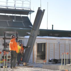 Girder being lifted into the right-field bleachers -