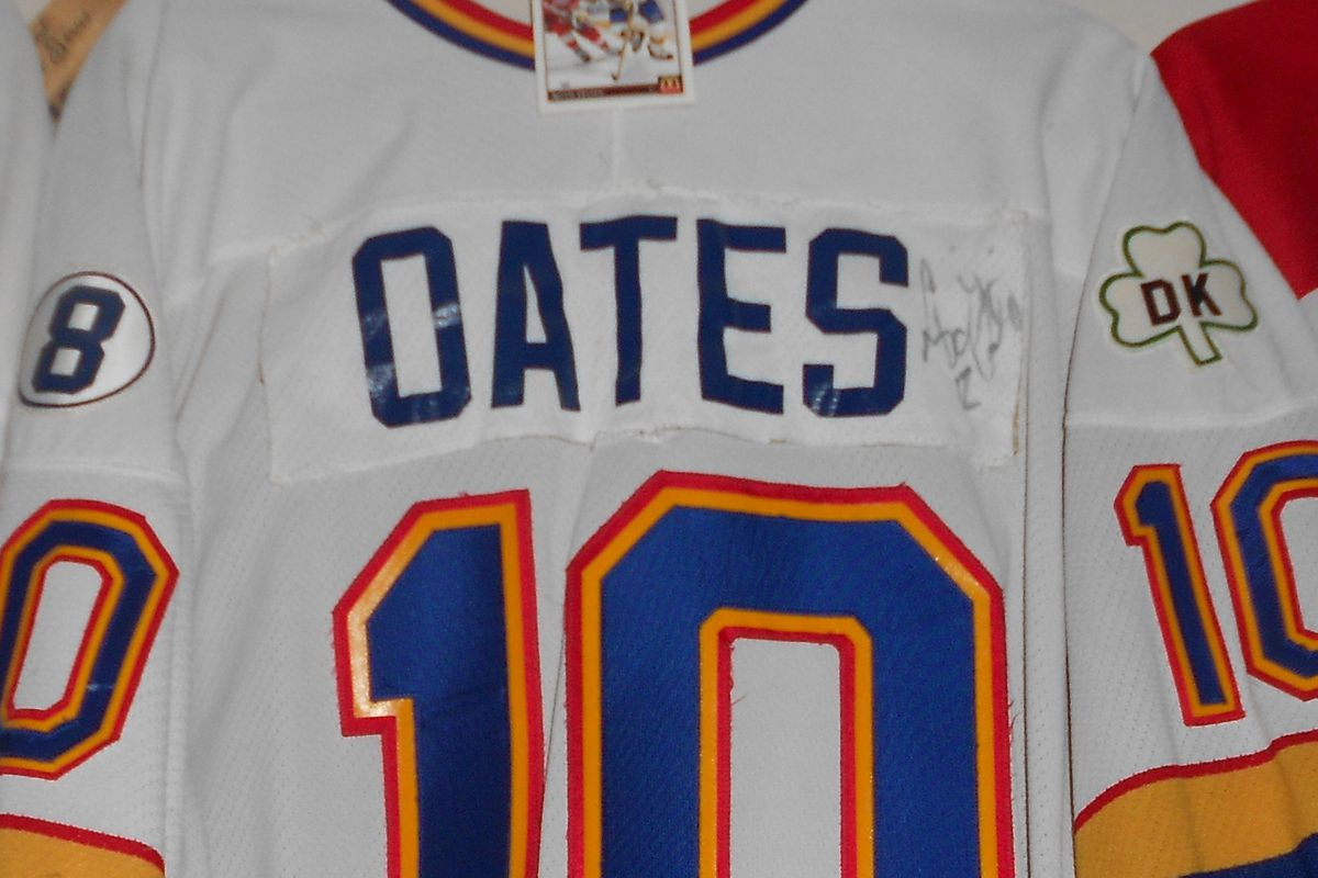 nusual 1988 game worn signed Adam Oates Blues jersey. Although Oates personally denied it, this was sold to me by the Blues as his first (temporary) jersey after acquired from Detroit. Signed card at top.