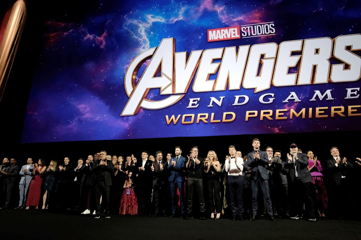 """The cast of """"Avengers: Endgame"""" stands onstage during the world premiere event on April 23 in Los Angeles."""