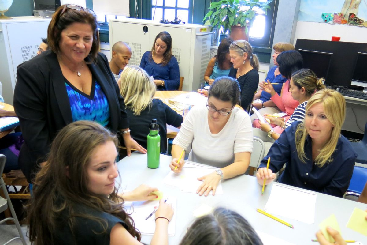 Principal Linda Mazza (left) discussed ways to spend the new 80-minute sessions with teachers at P.S. 295 in Park Slope on Monday.
