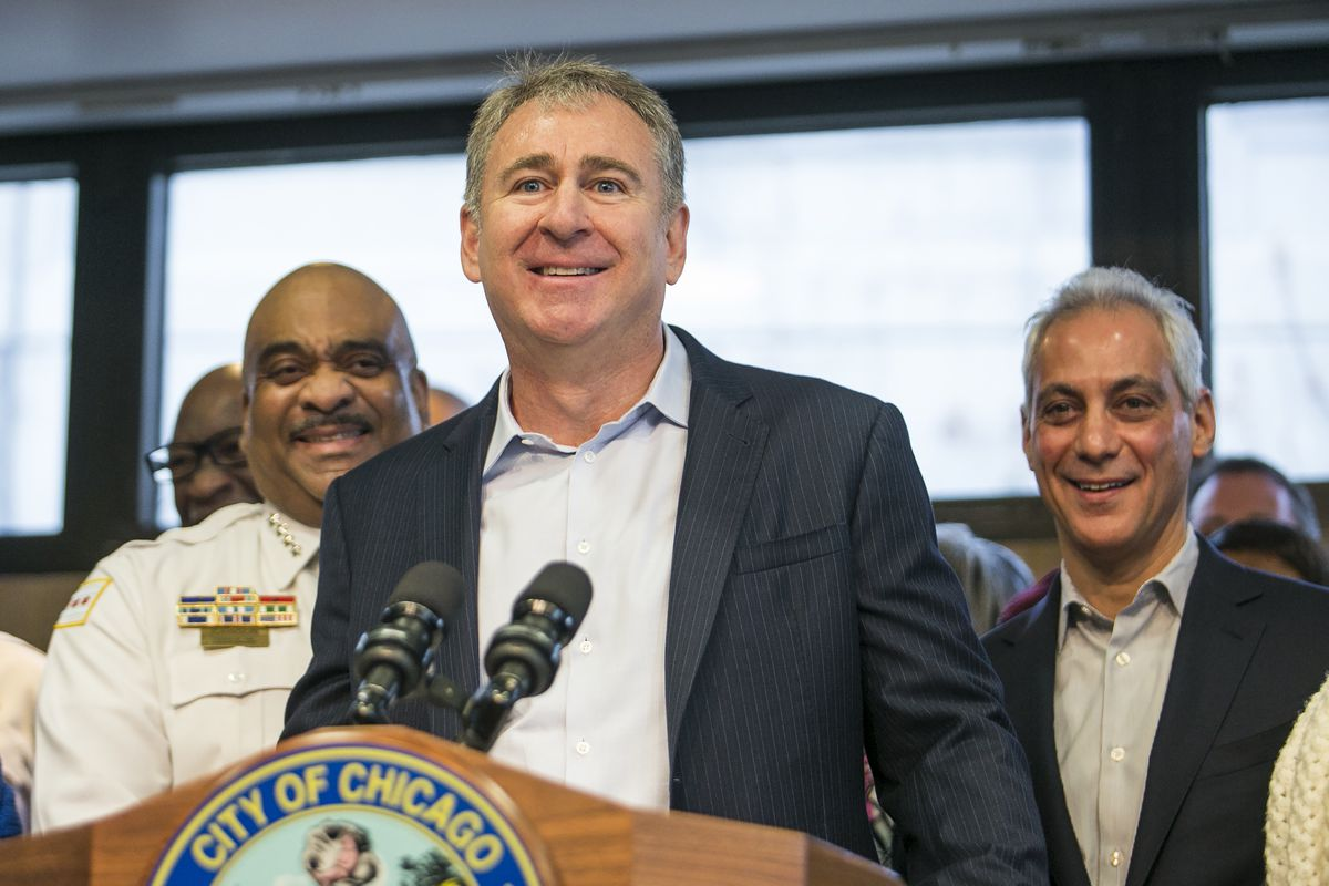 Billionaire Ken Griffin, center, discusses a $10 million donation to reduce gun violence in 2018 as then Police Supt. Eddie Johnson, left, and Mayor Rahm Emanuel, right, look on.