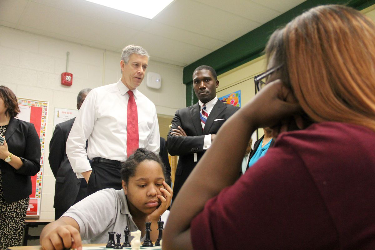 U.S. Education Secretary Arne Duncan talks Friday with Lionel Cable, principal of Douglass K-8 Optional School in Memphis and part of the Innovation Zone for Shelby County Schools.