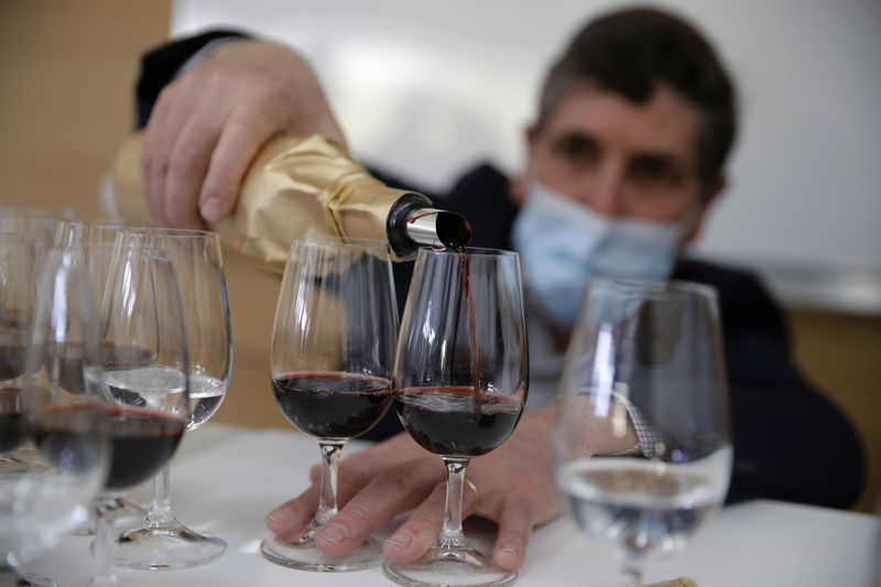 Philippe Darriet, Président of the Institute for wine and vine research and head oenologist fills glasses with wine for a blind tasting at the ISVV Institue in Villenave-d'Ornon, southwestern France. Twelve connoisseurs sampled one of the space-traveled wines, blindly tasting it alongside a bottle from the same vintage that had stayed in a cellar.