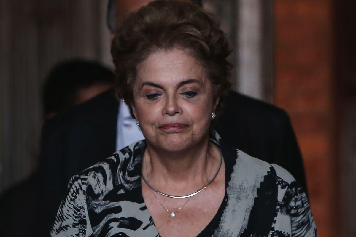 Brazil's President Dilma Rousseff walks in the Oswaldo Cruz Foundation on March 10, 2016, in Rio de Janeiro, Brazil.