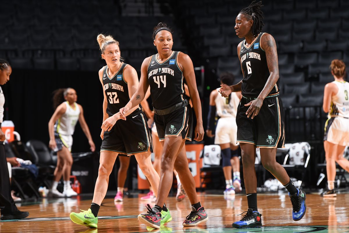 Sami Whitcomb #32 of the New York Liberty, Betnijah Laney #44 of the New York Liberty and Natasha Howard #6 of the New York Liberty talk during the game against the Dallas Wings on May 24, 2021 at Barclays Center in Brooklyn, New York.
