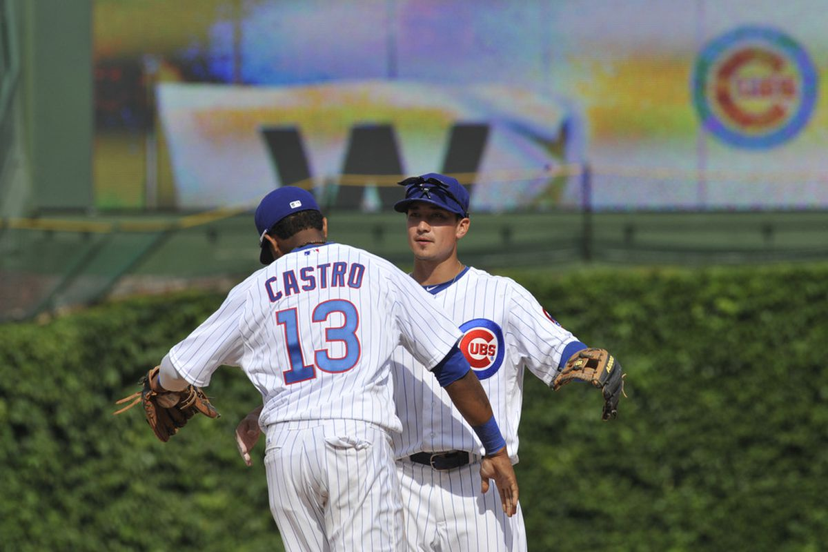 Darwin Barney of the Chicago Cubs and Starlin Castro celebrate the Cubs victory over the Padres at Wrigley Field in Chicago, Illinois. The Chicago Cubs defeated the San Diego Padres 11-7.  (Photo by David Banks/Getty Images)