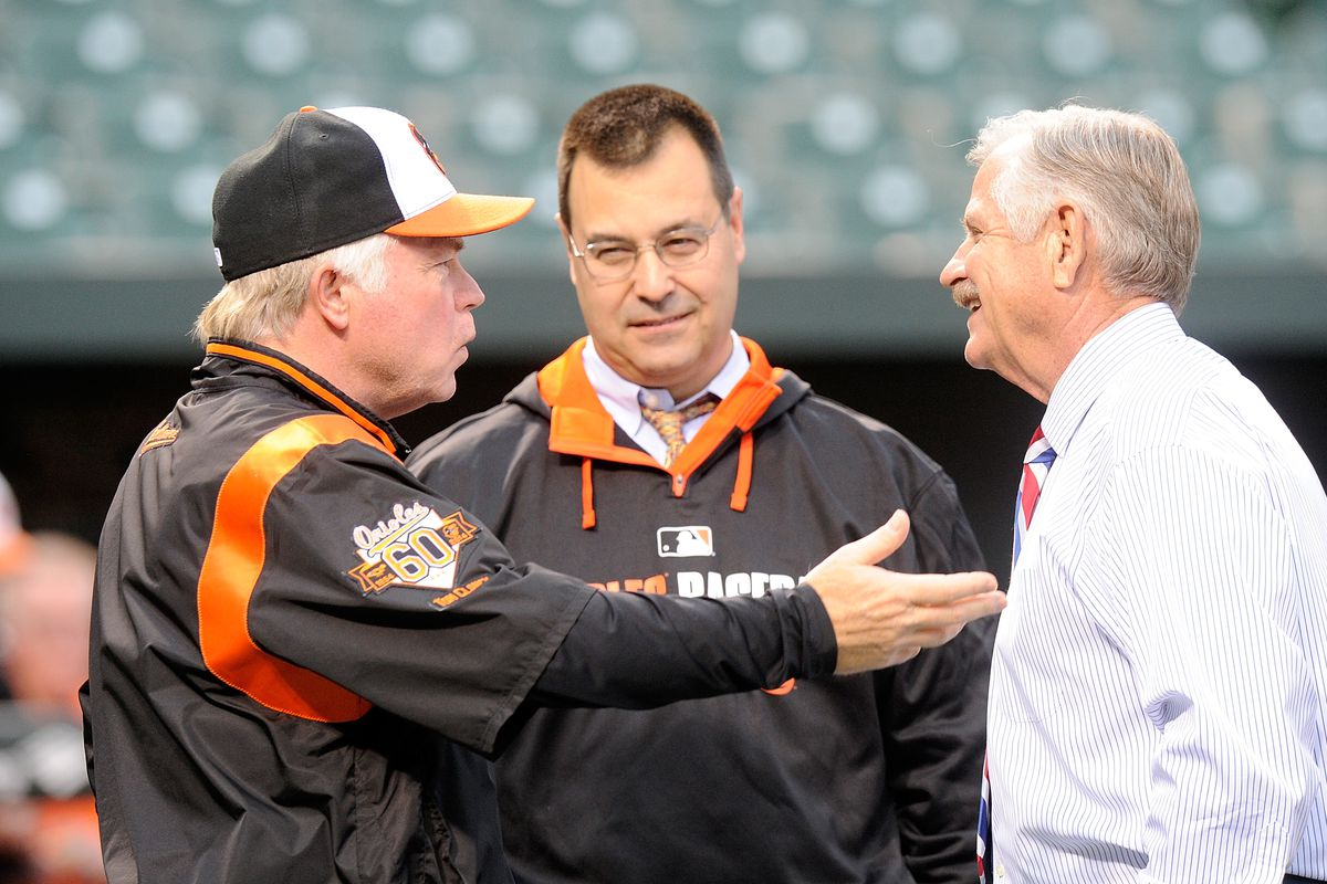 Dan Duquette with Buck Showalter and Rick Dempsey. Duquette is smiling.