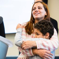Lidia Souza with her Son, Diogo, 9, after they were reunited Thursday. | James Foster/For the Sun-Times