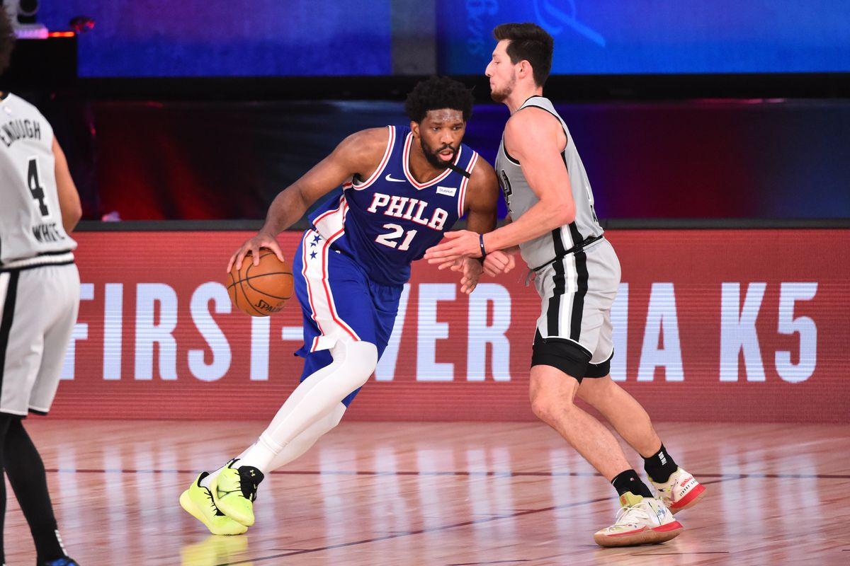 Joel Embiid of the Philadelphia 76ers drives to the basket against the San Antonio Spurs on August 3, 2020 at the Visa Athletic Center at ESPN Wide World of Sports in Orlando, Florida.