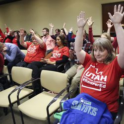 Angelique Morrill raises her hands in support of a public commenter during a Tax Restructuring and Equalization Task Force meeting in the House Building on the state Capitol campus in Salt Lake City on Monday, Nov. 25, 2019.