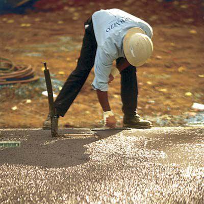Man Trowels Surface Of Terrazzo Floor
