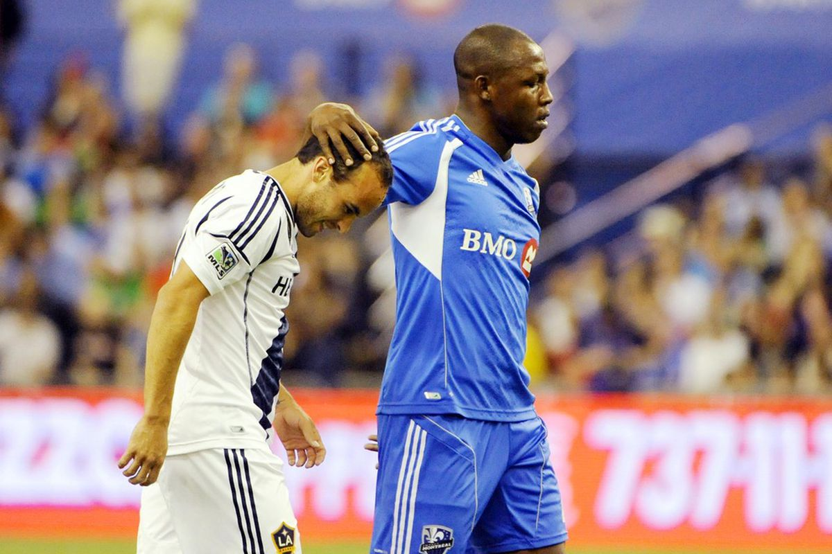 May 12, 2012; Montreal, QC, Canada; Los Angeles Galaxy midfielder Landon Donovan (10) and Montreal Impact defender Nelson Rivas (2) during the first half  at the Olympic Stadium.  Mandatory Credit: Eric Bolte-US PRESSWIRE
