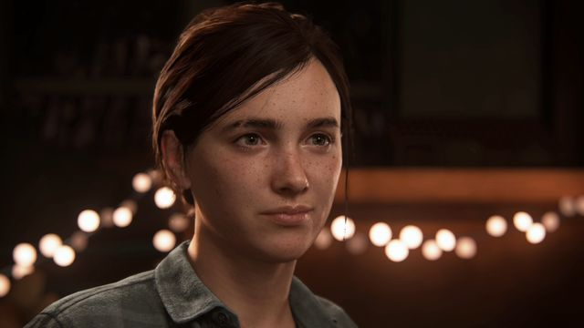 Ellie with lights behind her in The Last of Us Part 2