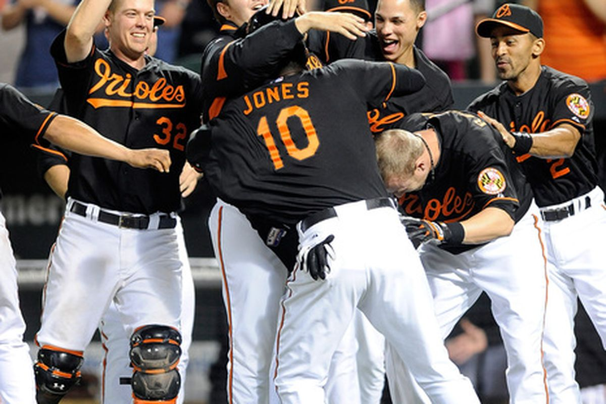 Man, I love walkoff wins.  (Photo by Greg Fiume/Getty Images)