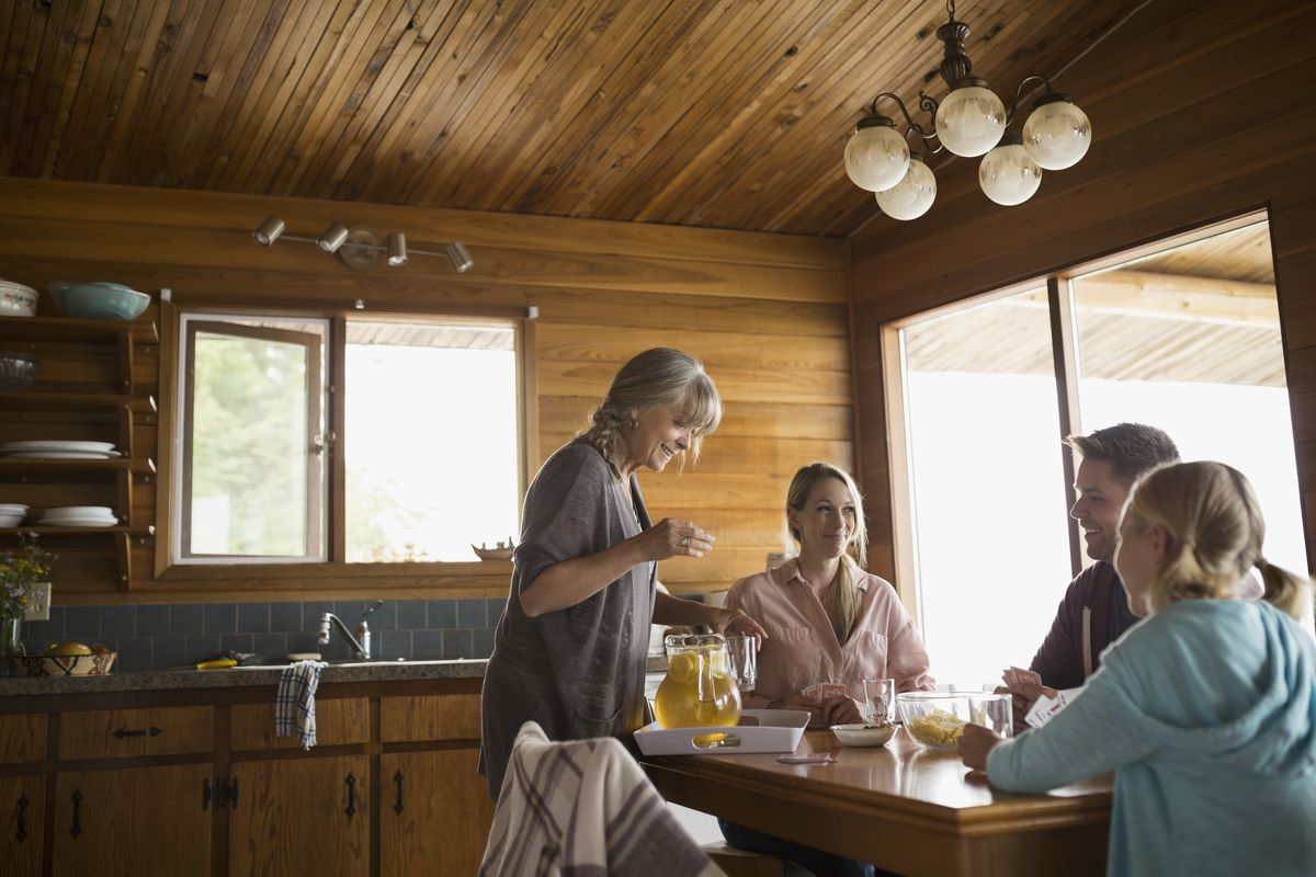 Multi-generation family at cabin dining table