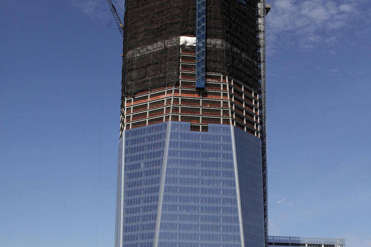 FILE- In this April 17, 2012, file photo, One World Trade Center, now up to 100 floors, rises above the  Manhattan skyline in New York. On Monday, April 30, One World Trade Center _ being built to replace the twin towers destroyed on 9/11 _ gets steel col