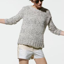 Marled drop shoulder sweater and Collection sequin shorts.
