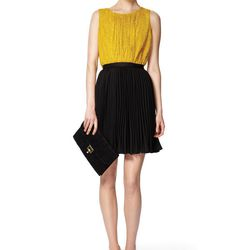 Look 1: Textured Pleated-Front Peplum Top in Gold, $32.99 Pleated Skirt in Black, $29.99 Also Available in Navy Floral Lace Clutch in Black, $29.99