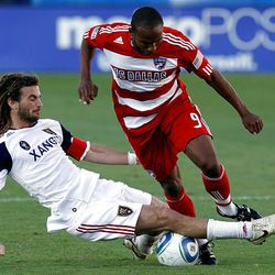 Real Salt Lake midfielder Kyle Beckerman trips up FC Dallas forward Jeff Cunningham during Saturday's RSL loss at Pizza Hut Park in Frisco, Texas.