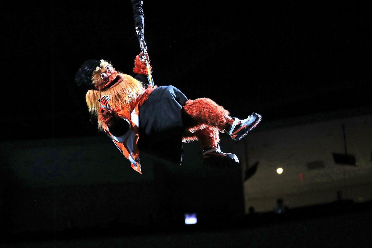 Gritty rappelling down to the ice before a Ducks-Flyers game