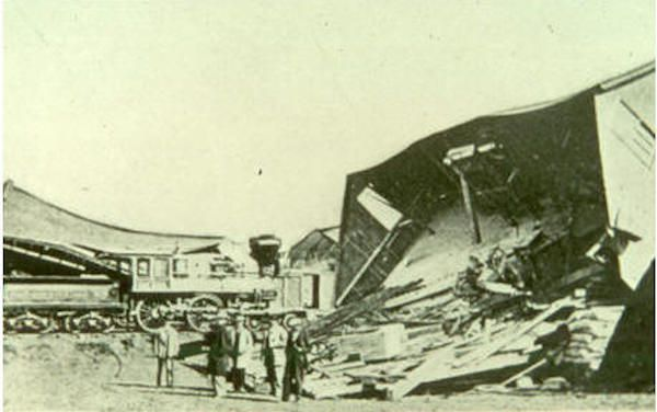 A black and white photo of a collapsed sawmill.