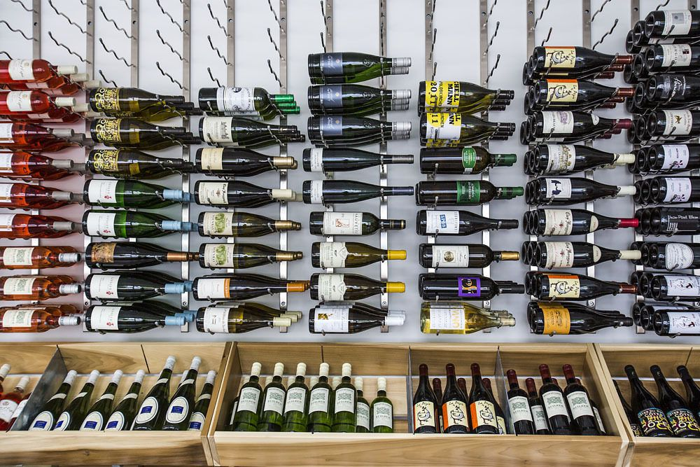 The racks at Vif Wine and Coffee displaying different wine bottles.
