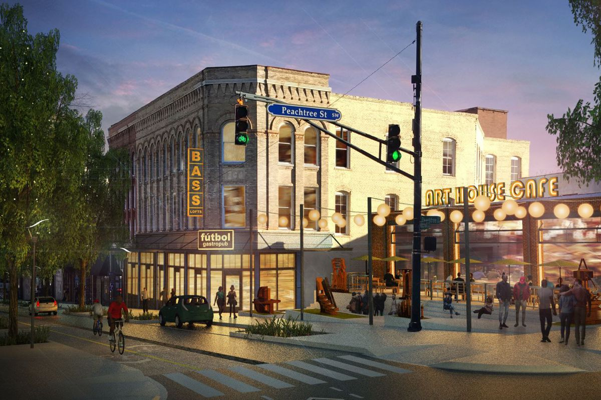 A restored three-story commercial building at the core of a vibrant, walkable district.