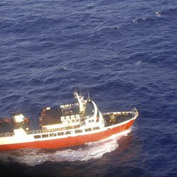 The vesel Pulupaki searches for survivors after a ferry carrying 49 passengers and 30 crew sank 55 miles northeast of the Tongan capital Nuku'alofa around midnight Wednesday.