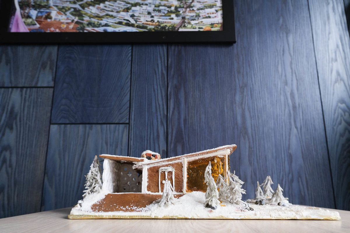 A gingerbread house on a table.