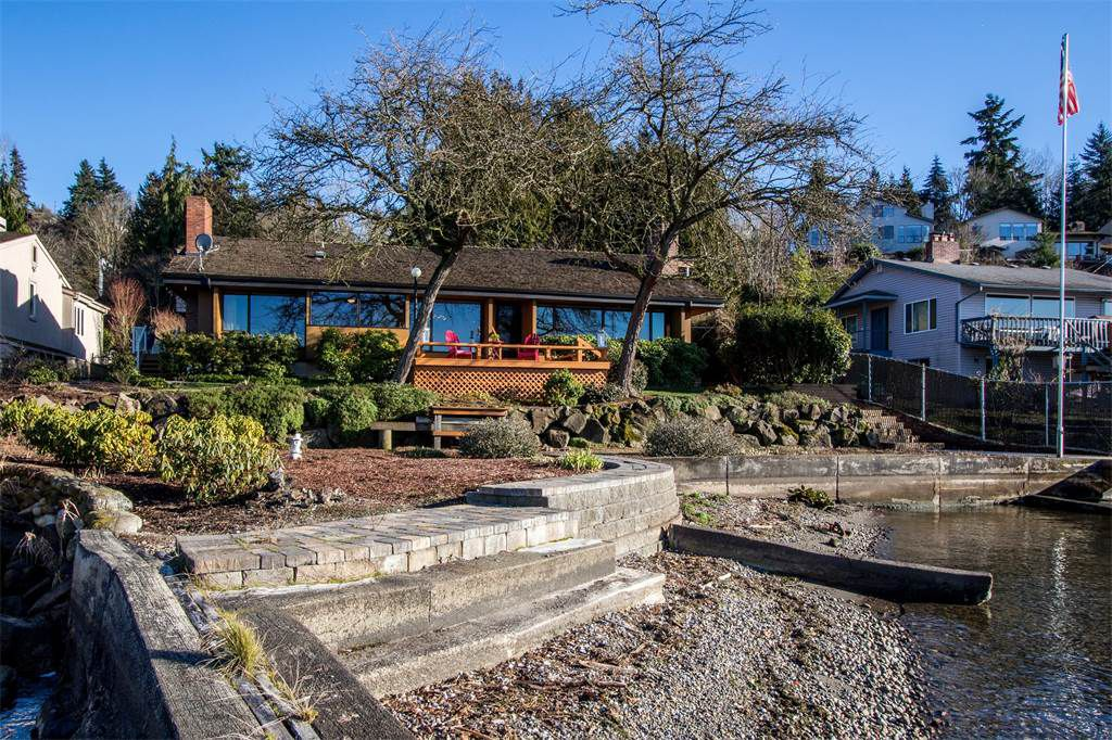 A view of a house with large windows from a dock in Lake Washington