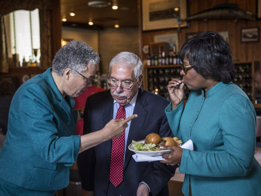 Then Cook County Democratic Chairman Joe Berrios, center, talks with County Board President Toni Preckwinkle and Ald. Michelle Harris at a party meeting in 2016. File Photo.   Rich Hein/Sun-Times file photo