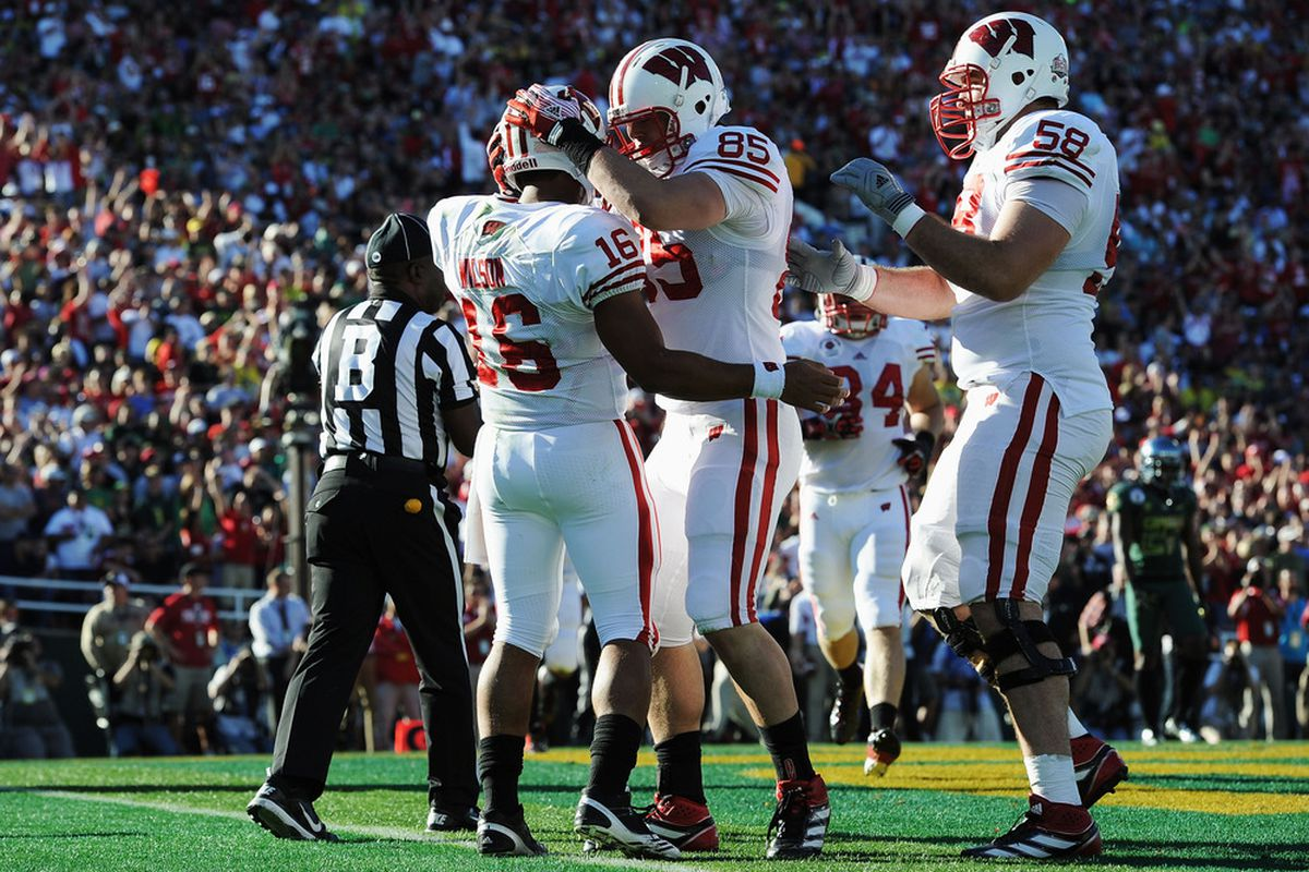 Wisconsin's offensive line has been tabbed as potentially the best in the conference. There are still plenty of questions, however.