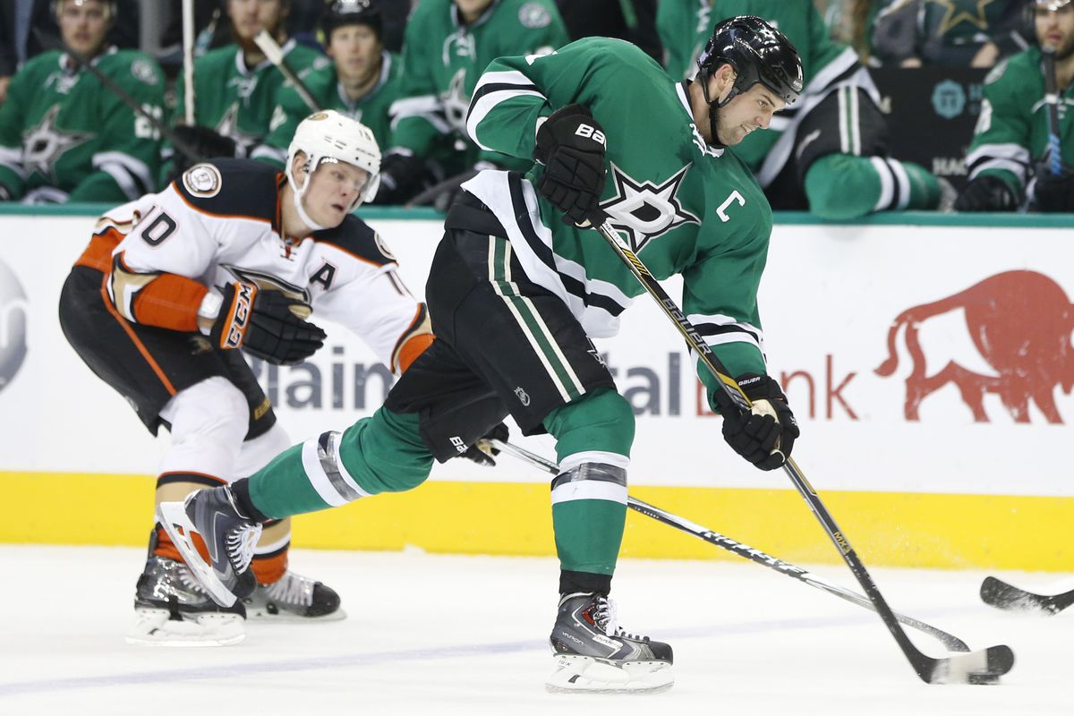 Jamie Benn takes a shot with Corey Perry backchecking last season at American Airlines Arena.