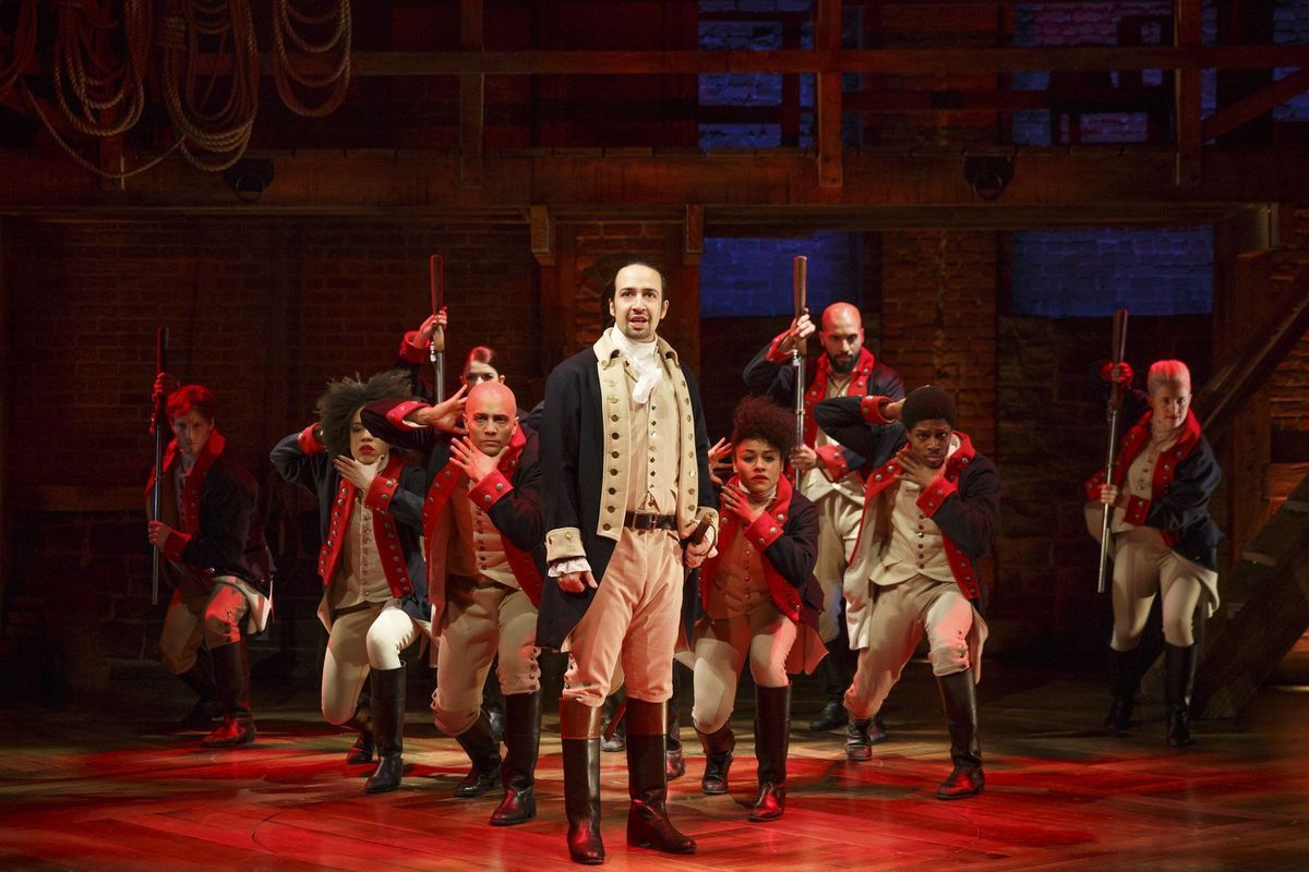 """Lin-Manuel Miranda, center, is the creator, composer and original title character in the hit musical """"Hamilton,"""" shown here in the """"Yorktown"""" scene in the original Broadway production."""
