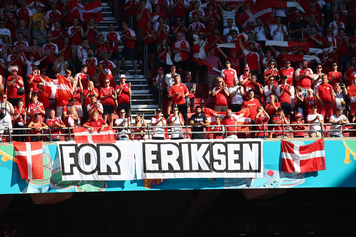 Denmark supporters display a banner for Christian Eriksen, the Danish player who collapsed during the match against Finland on June 12.