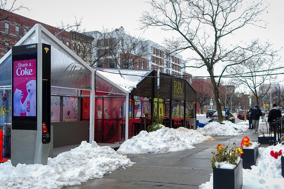Outdoor dining structures for restaurants in Harlem