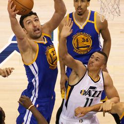 Golden State Warriors center Zaza Pachulia (27) reaches for the rebound over Utah Jazz guard Dante Exum (11) during game 4 of the second round of NBA playoffs at the Vivint Smart Home Arena in Salt Lake City on Monday, May 8, 2017. Golden State Warriors guard Shaun Livingston (34) is behind them.