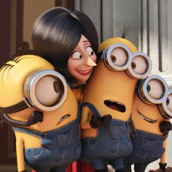 """Scarlet Overkill (voiced by Sandra Bullock), the first-ever female supervillain, squeezes (left to right) Stuart, Kevin and Bob tight in """"Minions."""""""