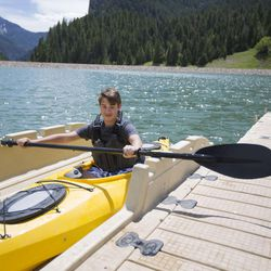 Rylan West, 15, prepares to pull himself out of his kayak on a sunny day at Tibble Fork Reservoir on Thursday, June 15, 2017.