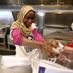 Samia Ibrahim cleans up after cooking with the Real Food Rising Summer Youth Program at Head Start in South Salt Lake on Wednesday, July 13, 2016.